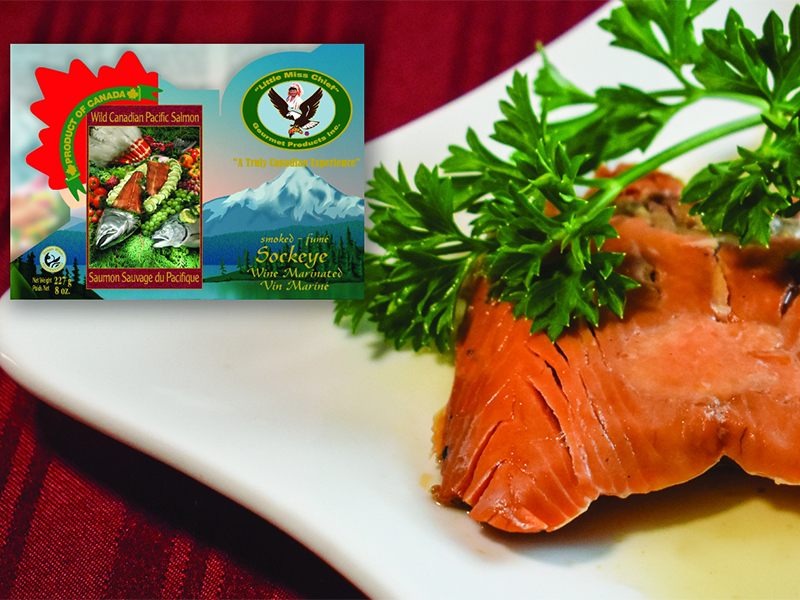 Image of cooked salmon on a plate with garnish. Little Miss Chief salmon packaging displayed on the top left.